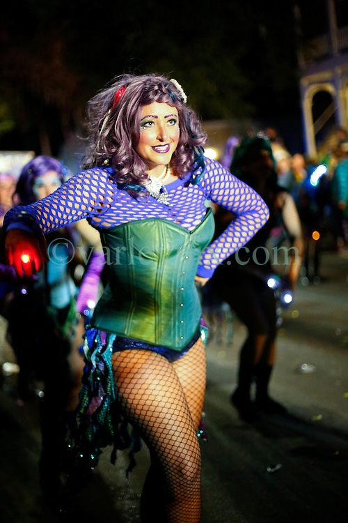 03 February 2016. New Orleans, Louisiana.<br /> Mardi Gras. A dancer with the all female Mystic Krewe of Nyx as the Krewe parades along Magazine Street.<br /> Photo©; Charlie Varley/varleypix.com