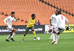 South Africa: Johannesburg: Bafana Bafana player Percy Tau battle for the ball with Seychelles players Karl Hopprich(L) and Colin Bibi(R) during the Africa Cup Of Nations qualifiers at FNB stadium, Gauteng.<br />