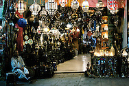 Morocco, Marrakesh. Man sitting at the lamp shop.