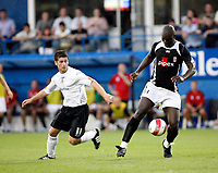 Photo: Marc Atkins.<br /> Luton Town v Fulham. Pre Season Friendly. 21/07/2006.<br /> Papa Douba Diop (R) controls the ball closely watched by Luton's Steve Robinson.
