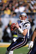 PITTSBURGH, PA - JANUARY 27: Tom Brady #12 of the New England Patriots looks to pass the football during the AFC Championship game against the Pittsburgh Steelers at Heinz Field on January 27, 2002 in Pittsburgh, Pennsylvania. The Patriots defeated the Steelers 24-17. (Photo by Joe Robbins) *** Local Caption *** Tom Brady