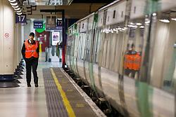 © Licensed to London News Pictures. 13/12/2016. London, UK. Southern rail workers at Victoria Station in London on 13 December 2016, as hundreds of thousands of rail passengers face a 3 day all-out strike in an escalating dispute over the role of conductors between Southern Rail and the RMT Union. Photo credit: Tolga Akmen/LNP