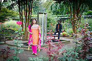 Lovely Indian couple enjoys a photography session in a public garden. <br />