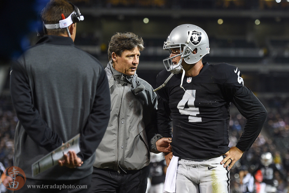August 15, 2014; Oakland, CA, USA; Oakland Raiders quarterback Derek Carr (4) leaves the field after an injury during the fourth quarter against the Detroit Lions at O.co Coliseum.