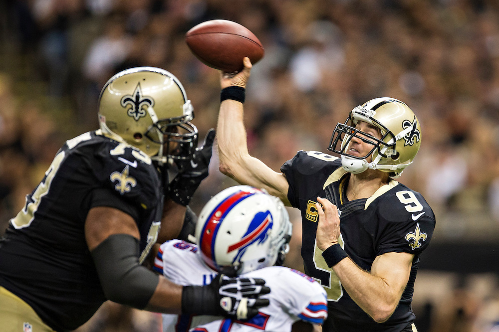 NEW ORLEANS, LA - OCTOBER 27:  Drew Brees #9 of the New Orleans Saints throws a pass against the Buffalo Bills at Mercedes-Benz Superdome on October 27, 2013 in New Orleans, Louisiana.  The Saints defeated the Bills 35-14.  (Photo by Wesley Hitt/Getty Images) *** Local Caption *** Drew Brees
