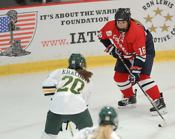 PITTSBURGH, PA - OCTOBER 15:  Emma Low-A-Chee #16 of the Robert Morris Colonials handles the puck in front of Rachel Khalouf #20 of the Vermont Catamounts in the first period during the game at 84 Lumber Arena on October 15, 2016 in Pittsburgh, Pennsylvania. (Photo by Justin Berl)