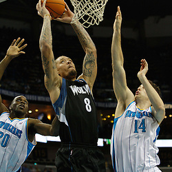 February 7, 2011; New Orleans, LA, USA; Minnesota Timberwolves power forward Michael Beasley (8) dunks over New Orleans Hornets power forward Jason Smith (14) and small forward Quincy Pondexter (20) during the fourth quarter at the New Orleans Arena. The Timberwolves defeated the Hornets 104-92.  Mandatory Credit: Derick E. Hingle