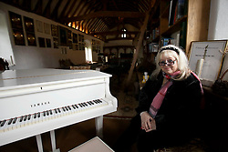 UK ENGLAND THAME 27AUG14 - Dwina Gibb, widow of Bee Gee Robin Gibb poses for a photo at the white piano in the rectory of their home in Thame, Oxfordshire.<br /> <br /> jre/Photo by Jiri Rezac<br /> <br /> © Jiri Rezac 2014
