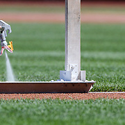 NEW YORK, NEW YORK - APRIL 13: Ground staff spray white lines on the infield before the Miami Marlins Vs New York Mets MLB regular season ball game at Citi Field on April 13, 2016 in New York City. (Photo by Tim Clayton/Corbis via Getty Images)
