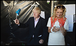 Boris Johnson with Tess Daly backstage at the Celebration of the 2012 Olympic Games volunteering one year on at the  Queen Elizabeth Olympic Park.<br /> Mayor of London Boris Johnson and Lord Coe will be taking to the stage at Go Local to encourage a new drive in volunteering one year on from the Games. Also present are multi-platinum selling pop rock band McFly; world famous comedian Eddie Izzard, Brit Award nominated The Feeling, and Britain'Got Talent winners Attraction, in addition to stars Jack Carroll and Gabz. The event will be the UKs biggest ever celebration of volunteering and first Olympic and Paralympic legacy event at Queen Elizabeth Olympic Park.<br /> London, United Kingdom<br /> Friday, 19th July 2013<br /> Picture by Andrew Parsons / i-Images