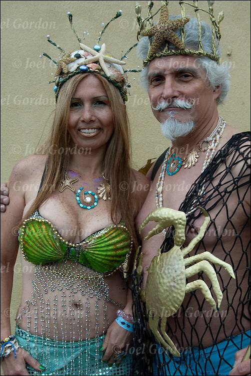 Mermaid Parade. couple as Neptune and Mermaid wearing colorful costume  before the start of the parade in Coney Island.