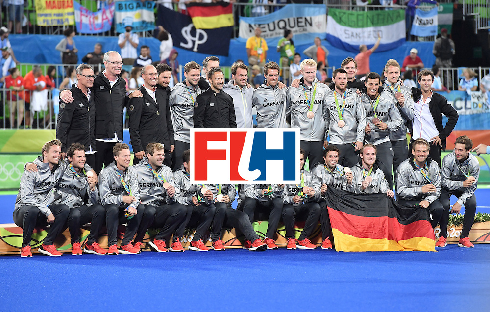 Germany's players celebrate on the podium with their bronze medals during the men's field hockey medals ceremony of the Rio 2016 Olympics Games at the Olympic Hockey Centre in Rio de Janeiro on August 18, 2016. / AFP / Pascal GUYOT        (Photo credit should read PASCAL GUYOT/AFP/Getty Images)