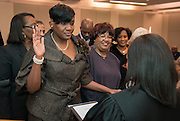 Houston ISD trustee Wanda Adams takes the oath of office during a ceremony, January 16, 2014.