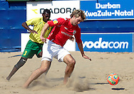 07 December 2006, Brazils Marcelo Bueno defends against England's James Temple during the first game of the Vodacom Pro Beach Soccer Tour at Durban's Bay of Plenty on Thursday. Brazil won the game 10 - 3. Picture: Shayne Robinson, PhotoWire Africa