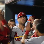Matt Holliday, St. Louis Cardinals, is congratulated by team mates after driving in a run during the St. Louis Cardinals six run sixth inning during the New York Mets Vs St. Louis Cardinals MLB regular season baseball game at Citi Field, Queens, New York. USA. 19th May 2015. Photo Tim Clayton