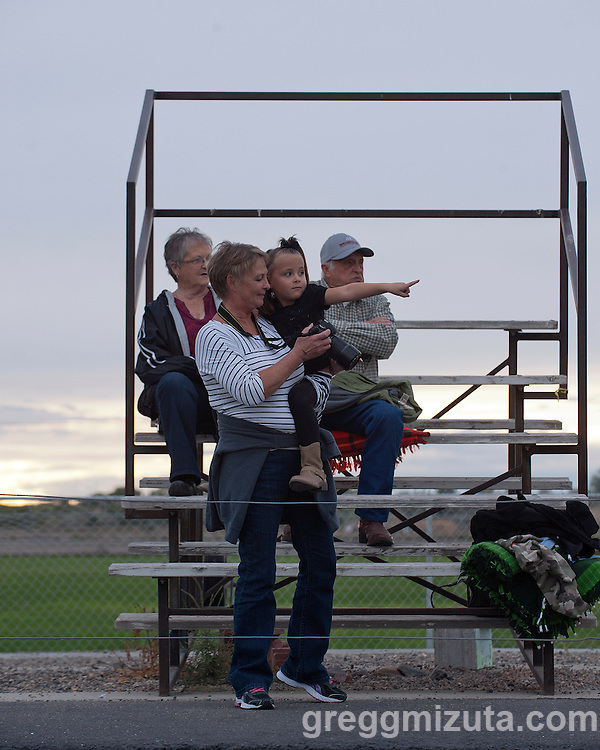 JoAnn and Tom Mooney take a seat on the far south side of Frank Hawley stadium for the Vale - Baker football game, September 26, 2014 at Vale, Oregon. Several years ago they had an exchange student, Alejandro Mesa. Tyson Mesa, Alejandro's son, is also an exchange student at Vale and handles the kickoff duties for the football team.