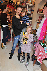 LIBERTY ROSS with her children SONNY (Tennyson) & SKYLA at the opening of the new HoneyJam children's store at 2 Blenheim Crescent, London W11 on 7th July 2011.