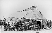 Native American men and children standing in front of a large tent structure; women stand to the side, 1898. Photogaph by  Dr Samuel J. Call (1858-1909)