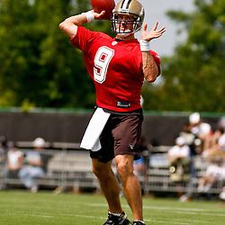 June 5, 2010; Metairie, LA, USA; New Orleans Saints quarterback Drew Brees (9) throws a pass during a mini camp practice at the New Orleans Saints practice facility. Mandatory Credit: Derick E. Hingle