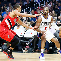 12 December 2016: Portland Trail Blazers guard C.J. McCollum (3) defends on LA Clippers guard Chris Paul (3) during the LA Clippers 121-120 victory over the Portland Trail Blazers, at the Staples Center, Los Angeles, California, USA.