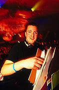 DJ Alex Gold selecting record during a dj set at Ultra Vegas UK 2000's