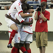 Orlando City Lions Midfielder Kevin Molino (18) celebrates with teammates after he scores a goal during a United Soccer League Pro soccer match between the Pittsburgh Riverhounds and the Orlando City Lions at the Florida Citrus Bowl on May 14, 2011 in Orlando, Florida. Orlando won the game 1-0. (AP Photo/Alex Menendez)