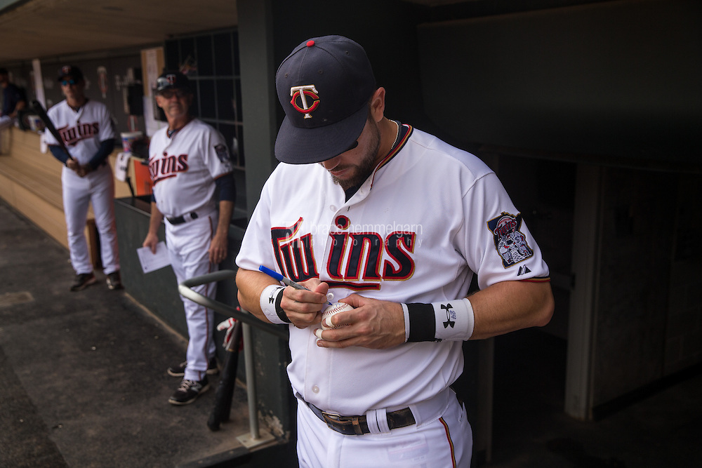 MINNEAPOLIS, MN-SEPTEMBER 20: Trevor Plouffe #24 of the Minnesota Twins signs an autograph for a fan against the Los Angeles Angels on September 20, 2015 at Target Field in Minneapolis, Minnesota. The Twins defeated the Angels 8-1. (Photo by Brace Hemmelgarn) *** Local Caption *** Trevor Plouffe