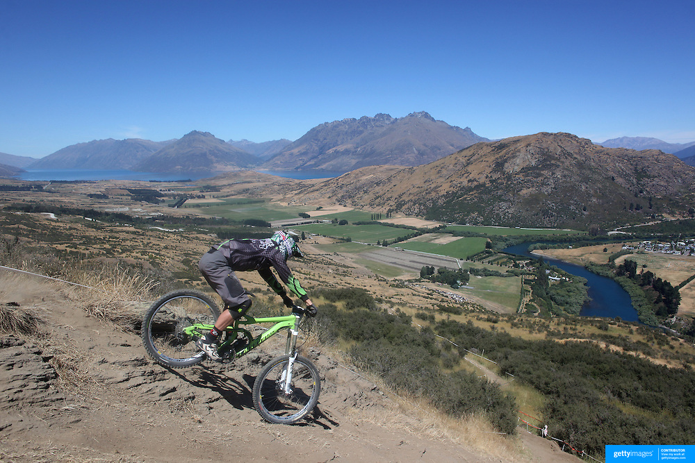 Jerome Clementz from France in action during the New Zealand South Island Downhill Cup Mountain Bike series held on The Remarkables face with a stunning backdrop of the Wakatipu Basin. 150 riders took part in the two day event. Queenstown, Otago, New Zealand. 9th January 2012. Photo Tim Clayton