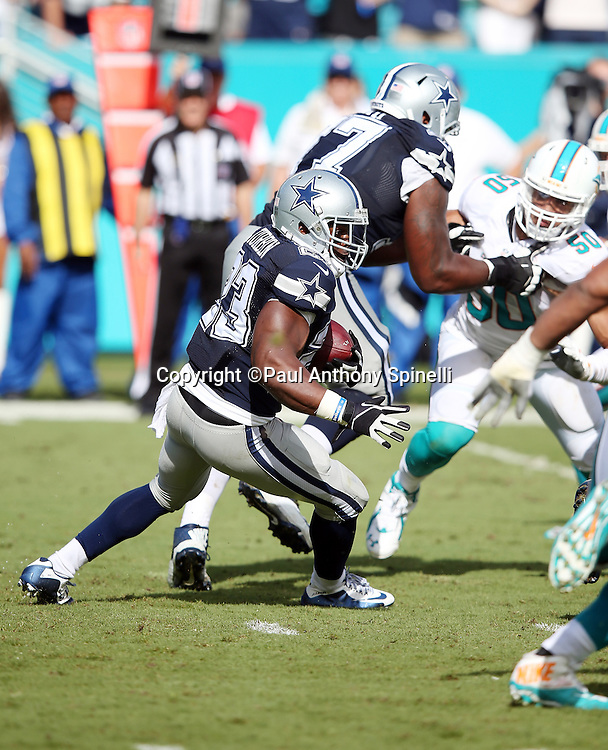 Dallas Cowboys running back Robert Turbin (23) runs the ball during the 2015 week 11 regular season NFL football game against the Miami Dolphins on Sunday, Nov. 22, 2015 in Miami. The Cowboys won the game 24-14. (©Paul Anthony Spinelli)