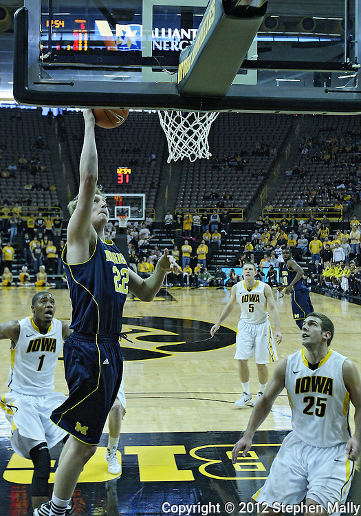 January 14, 2011: Michigan Wolverines forward Blake McLimans (22) puts up a shot as Iowa Hawkeyes guard/forward Eric May (25) and Iowa Hawkeyes forward Melsahn Basabe (1) look on during the NCAA basketball game between the Michigan Wolverines and the Iowa Hawkeyes at Carver-Hawkeye Arena in Iowa City, Iowa on Saturday, January 14, 2011. Iowa defeated Michigan 75-59.