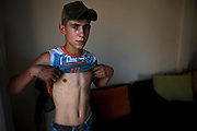 Alawite district Jabal Mohsen. Boy who was allegedly tortured  by Sunni who abducted him in the street. Lebanon, Tripoli