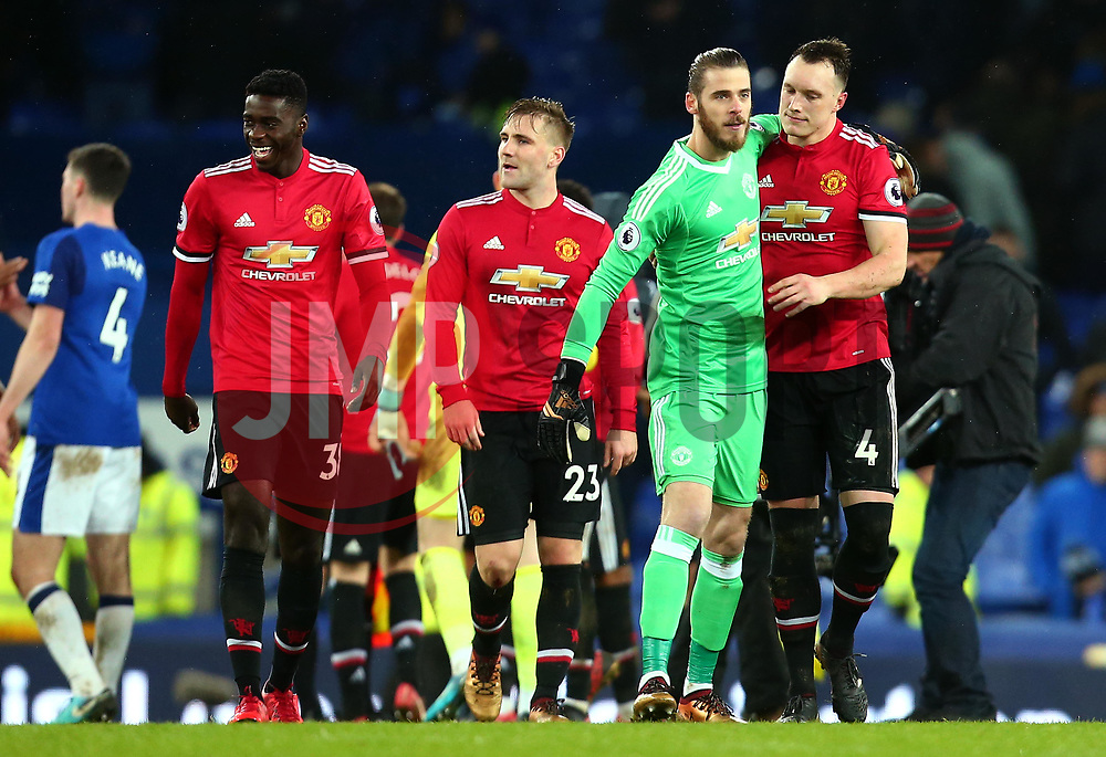 David De Gea of Manchester United and Phil Jones of Manchester United celebrate their side's win over Everton - Mandatory by-line: Robbie Stephenson/JMP - 01/01/2018 - FOOTBALL - Goodison Park - Liverpool, England - Everton v Manchester United - Premier League