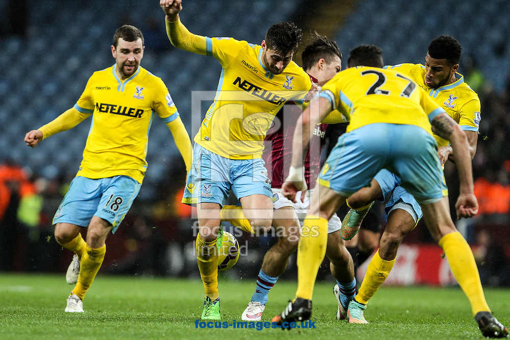 Jack Grealish of Aston Villa (centre) is surrounded by Crystal Palace players during the Barclays Premier League match at Villa Park, Birmingham<br /> Picture by Andy Kearns/Focus Images Ltd 0781 864 4264<br /> 01/01/2015