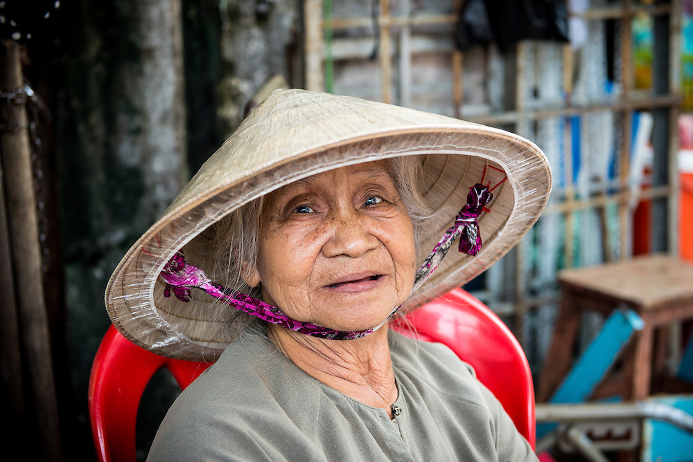 Elderly Vietnamese woman at a market in Ho Chi Minh City