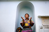 Guatemala San Raymundo, A indigenous women prays at the grave site for one of the two Presidential Candidate, and Nobel Peace Prize winner, Rigoberta Menchu campaign workers, who were found murdered earlier in the week is taken to its final resting place in San Raymundo Guatemala, Friday Sept 7, 2007.  Crime has become a serious issue in the upcoming elections that are to take place on Sept. 9 2007.  (photo by/ Darren Hauck).............
