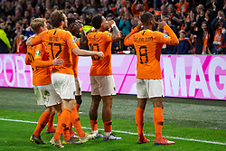 24-03-2019 NED: UEFA Euro 2020 qualification Netherlands - Germany, Amsterdam<br /> Netherlands lost the match 3-2 in the last minute / Memphis Depay #10 of The Netherlands scores the 2-2, Georginio Wijnaldum #8 of The Netherlands, Daley Blind #17 of The Netherlands, Frenky de Jong #21 of The Netherlands