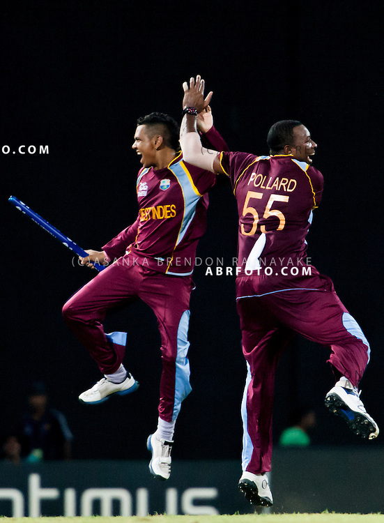 West Indian players Sunil Narine and Kieron Pollard celebrate after winning the match during the World T20 Cricket Mens Final match between Sri Lanka Vs West Indies at the R Premadasa International Cricket Stadium, Colombo. Photo credit : Asanka Brendon Ratnayake