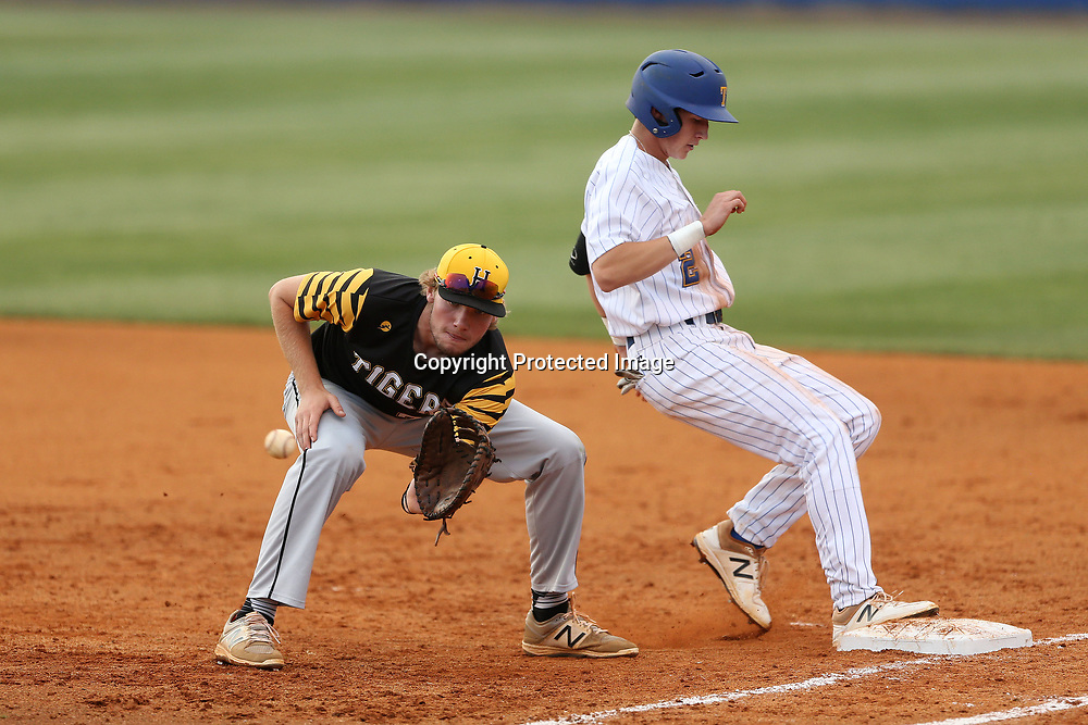 Tupelo's Charlie Greer gets back to first as Hernando's first baseman Ben Brantley goes for the catch and out against Tupelo Thursday night.