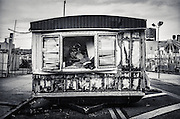 An abandoned trailer sits on a deserted street at the Coney Island amusement park , Brooklyn