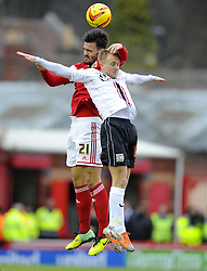 Bristol City's Marlon Pack battles for the high ball with Milton Keynes Dons' Ben Reeves - Photo mandatory by-line: Joe Meredith/JMP - Tel: Mobile: 07966 386802 18/01/2014 - SPORT - FOOTBALL - Ashton Gate - Bristol - Bristol City v MK Dons - Sky Bet League One