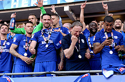 Cardiff City manager Neil Warnock (third from right) and the Cardiff City players celebrate winning their promotion to the Premier League after the Sky Bet Championship match at the Cardiff City Stadium.