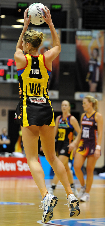 Jessica Tuki takes a clean pass for the Magic during action from the Major Semi Final of the ANZ Netball Championship played between the Firebirds and the Magic at the Gold Coast Convention and Exhibition Centre on Monday 9th May 2011