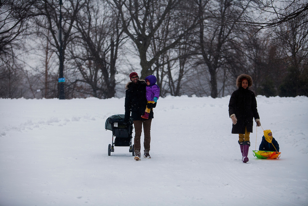 BROOKLYN, NY - JANUARY 26, 2015:  Adrien and Anna-Gaelle Wiesebron lead their children Emmeline and Nathanael Wiesebron out of Prospect Park during a snowstorm in Brooklyn. CREDIT: Sam Hodgson for The New York Times