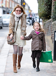 Geri Halliwell picking up her daughter Bluebell Madonna from school. London, UK. 11/03/2013<br />BYLINE MUST READ : KP/Gotcha Images<br /><br />Copyright by © Gotcha Images Ltd. All rights reserved.<br />Usage of this image is conditional upon the acceptance <br />of Gotcha Images Ltd, terms and conditions available at<br />www.gotchaimages.com