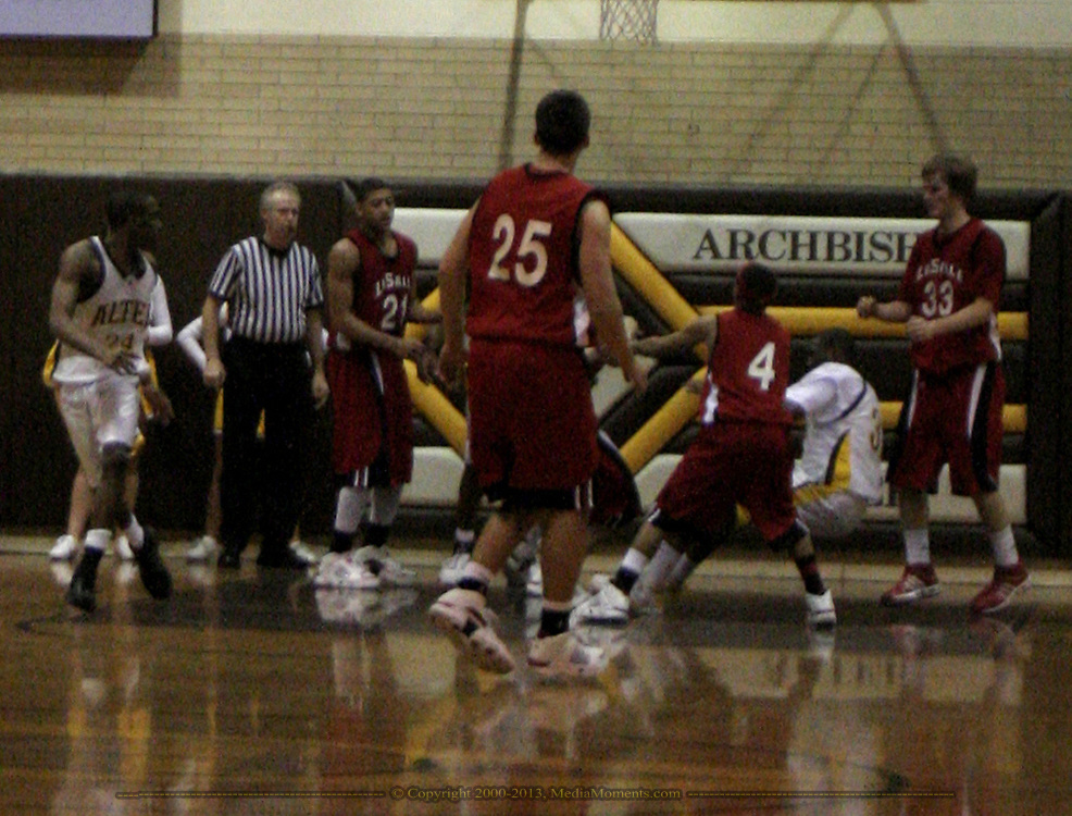 An incident late in the 4th period as the LaSalle Lancers play the Alter High School Knights in varsity basketball, Friday Night, January 26, 2007, at Alter's Joe Petrocelli Gymnasium.