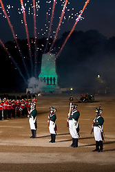© Licensed to London News Pictures. 13/06/2012. LONDON, UK. As fireworks detonate in the background re-enactors of the 'Moscow Militia' stand in line during a performance of Tchaikowsky's '1812 Overture' at the annual Beating Retreat parade at Horse Guards Parade in London. On two successive evenings each year in June a pageant of military music, precision drill and colour takes place on Horse Guards Parade in the heart of London when the Massed Bands of the Household Division carry out the Ceremony of Beating Retreat. 300 musicians, drummers and pipers perform this age-old ceremony. The Retreat has origins in the early days of chivalry when beating or sounding retreat pulled a halt to the days fighting. Photo credit: Matt Cetti-Roberts/LNP