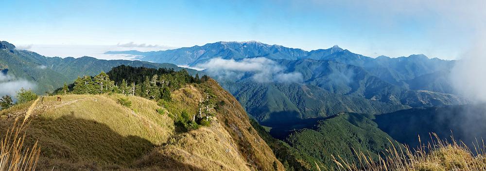 Snow Mountain's East Peak has stunning views in every direction.  To the north is the main peak of Snow Mountain, to the east is The Holy Ridge, and to the south is Nanhudashan (南湖大山)and Zhongyang Jianshan (中央尖山).