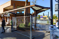 Metal barriers seal off the bus shelter and destroyed planter following Sunday's bus crash in which 19 people were injured including a teenage girl who is in critical condition. The bus driver was arrested on suspicion of drug driving. Croydon, South London November 12 2018.