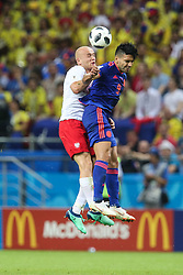 June 24, 2018 - Kazan, Russia - Michal Pazdan of Poland vies Radamel Falcao of Colombia during the Russia 2018 World Cup Group H football match between Poland and Colombia at the Kazan Arena in Kazan on June 24, 2018. Colombia won 0-3. (Credit Image: © Foto Olimpik/NurPhoto via ZUMA Press)