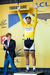 Prince Harrly (left) looks on as Marcel Kittel of Germany and Team Giant-Shimano celebrates with the leaders Yellow Jersey on the podium having won Stage 1 of the Tour de France in Harrogate - Photo mandatory by-line: Rogan Thomson/JMP - 07966 386802 - 05/07/2014 - SPORT - CYCLING - Harrogate, North Yorkshire - Le Tour de France Grand Depart Stage 1, Leeds to Harrogate.